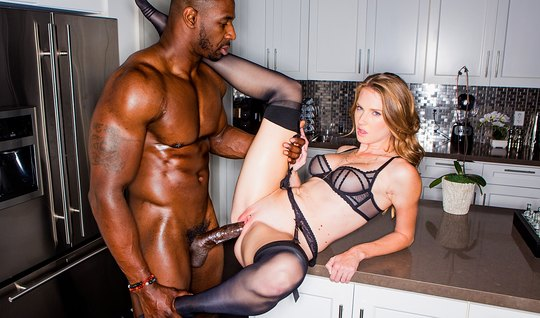 Beauty in a silk robe spreads her legs in front of hot black muscle du...