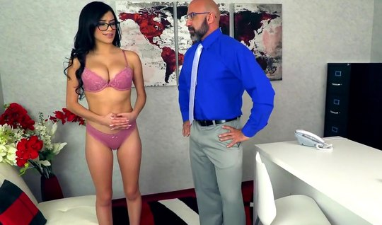 A bearded guy with glasses in the office crumpled his big boobs of a p...
