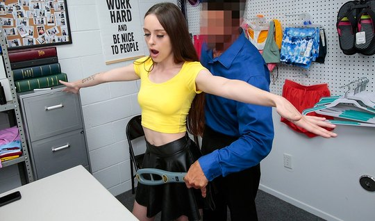 The brunette in the office beautifully caresses the thick cock of the ...